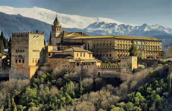 The Alhambra of Granada in Spain with Sierra Nevada snowy mountains as background.