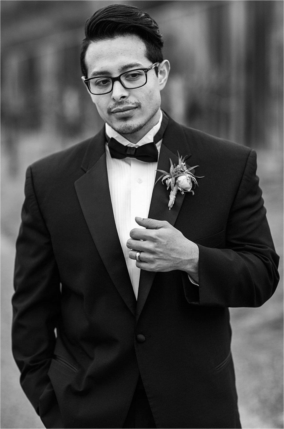 Black and White photo of a groom in a tux from Epiphany Bridal Boutique in Carmel Valley, CA.