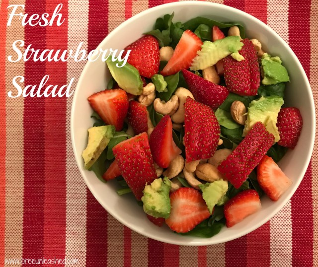 Here is a quick and easy dinner for a busy weeknight!  Strawberry salad with cashews, avocado, strawberries, and raspberry vinaigrette.
