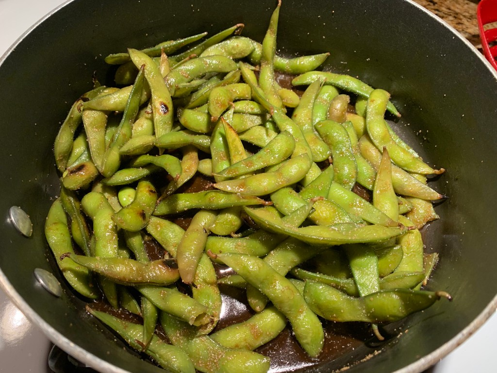 A bowl of edamame with garlic, salt, and coconut aminos.