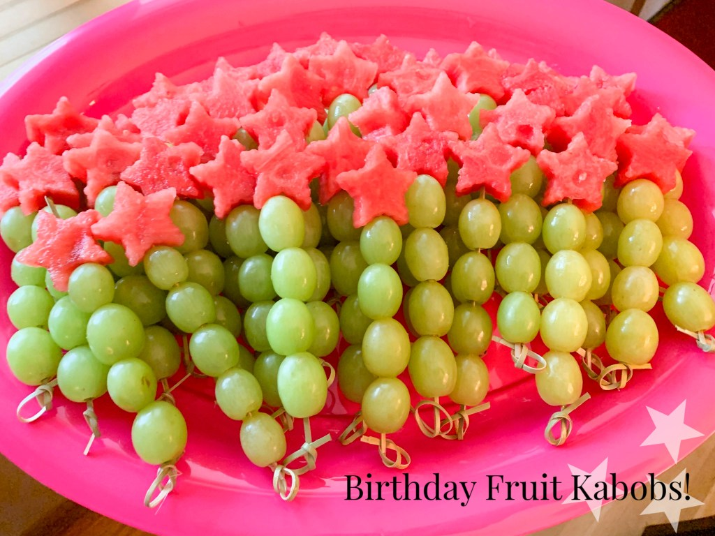 Birthday party fruit kabobs with green grapes and watermelon stars.