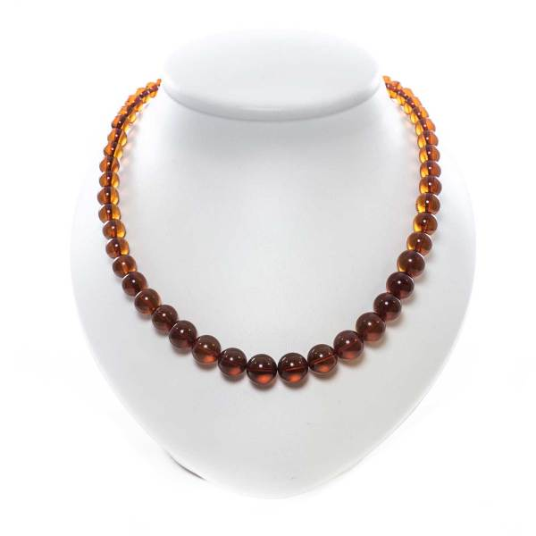 natural amber round beads bubbles on stand
