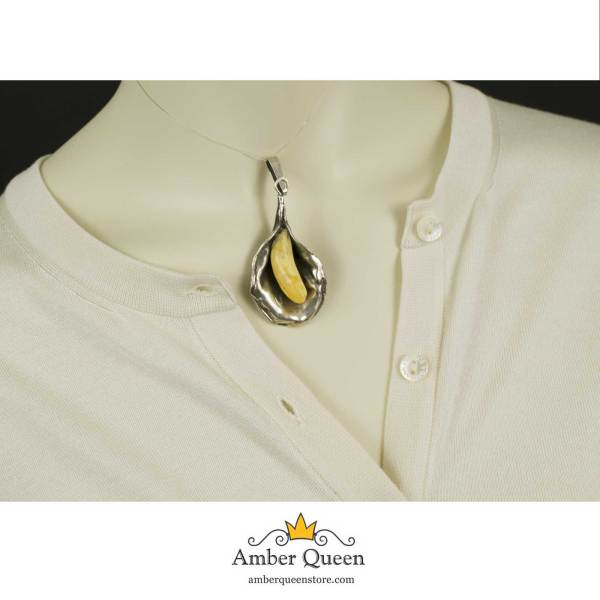 Vintage Silver Pendant With Yellow Amber on Mannequin closeup