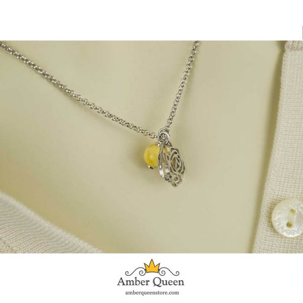 Silver Chain Necklace with Flower Pendant and Amber on Mannequin Close
