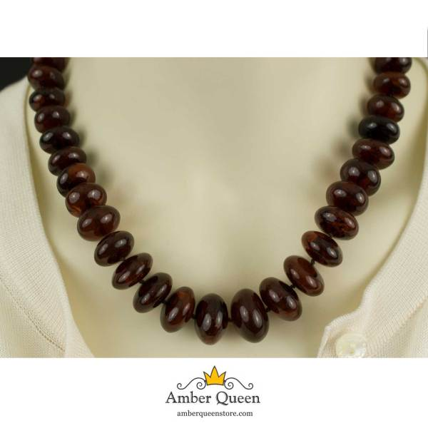 Solid Cherry Amber Necklace on Mannequin Closeup