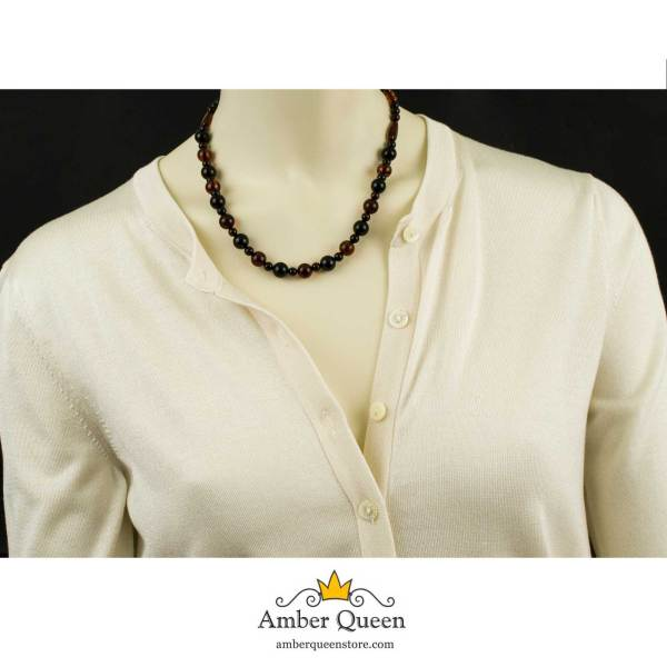 Cognac and Cherry Colors Amber Necklace on Mannequin