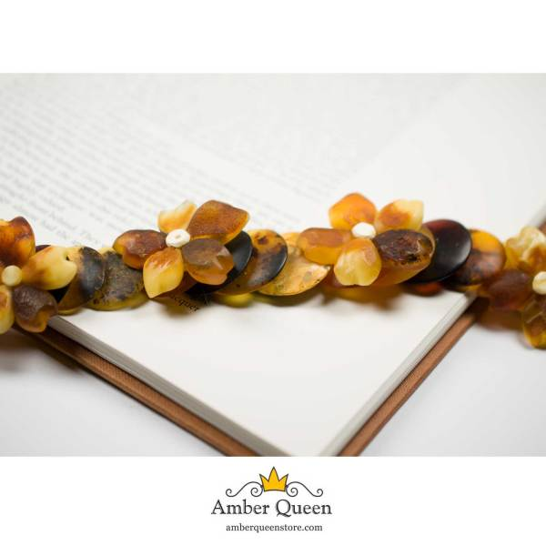Unpolished Amber Necklace with Flowers on Book