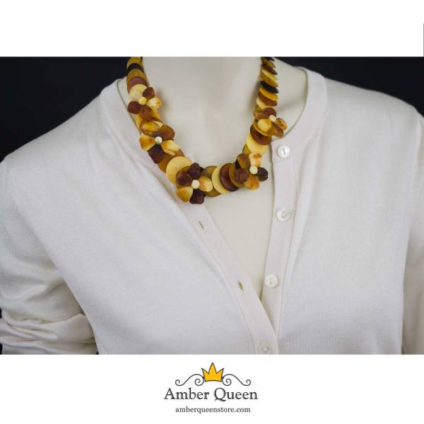 Gorgeous Necklace with Unpolished Amber Flowers on Mannequin