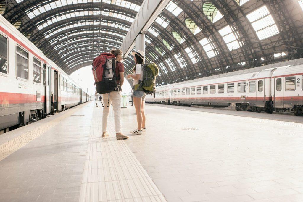 Backpackers at Milan train station, Italy-original