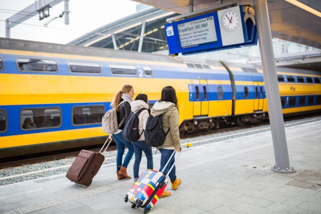 Friends on a platform at Utrecht Central Station, The Netherlands-original