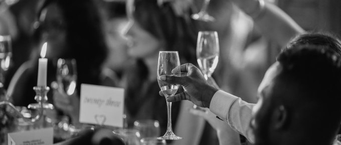 People raising champagne glasses in a toast