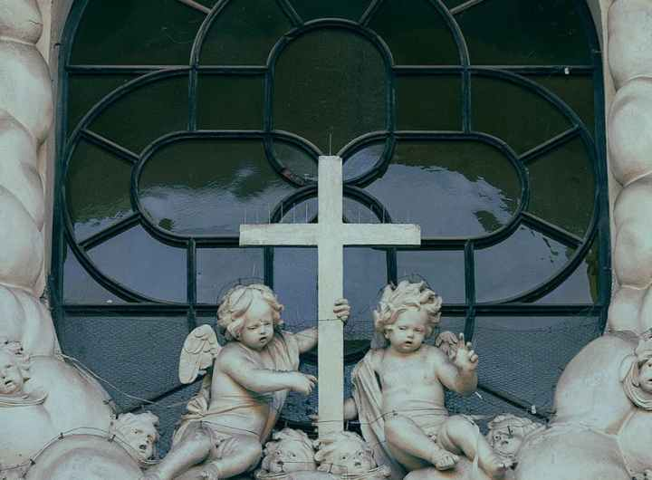 sculptures of angels near cathedral window