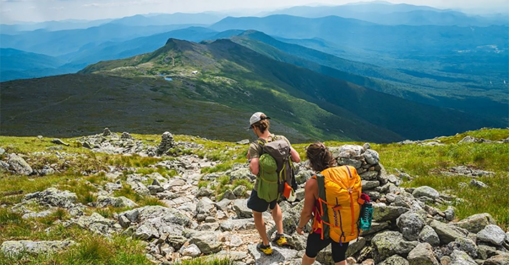 two adults hiking in the White Mountains of New Hampshire