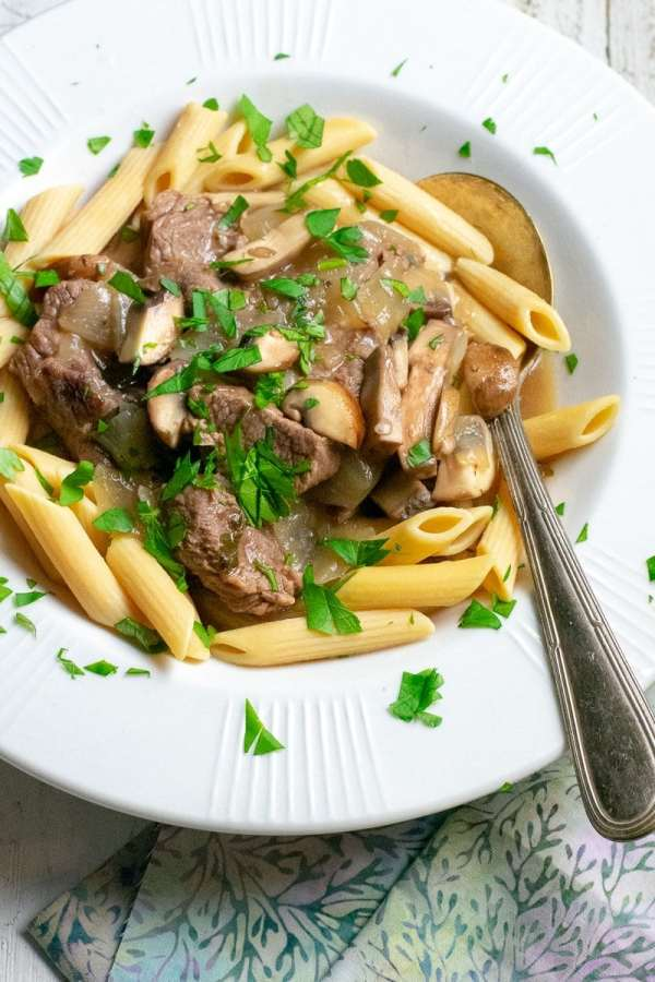 40 minute Instant Pot Beef Stroganoff from side in white bowl