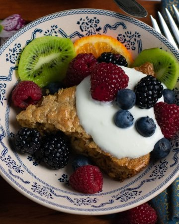 Flourless Oatmeal Baked Pancake wedge in blue and white bowl