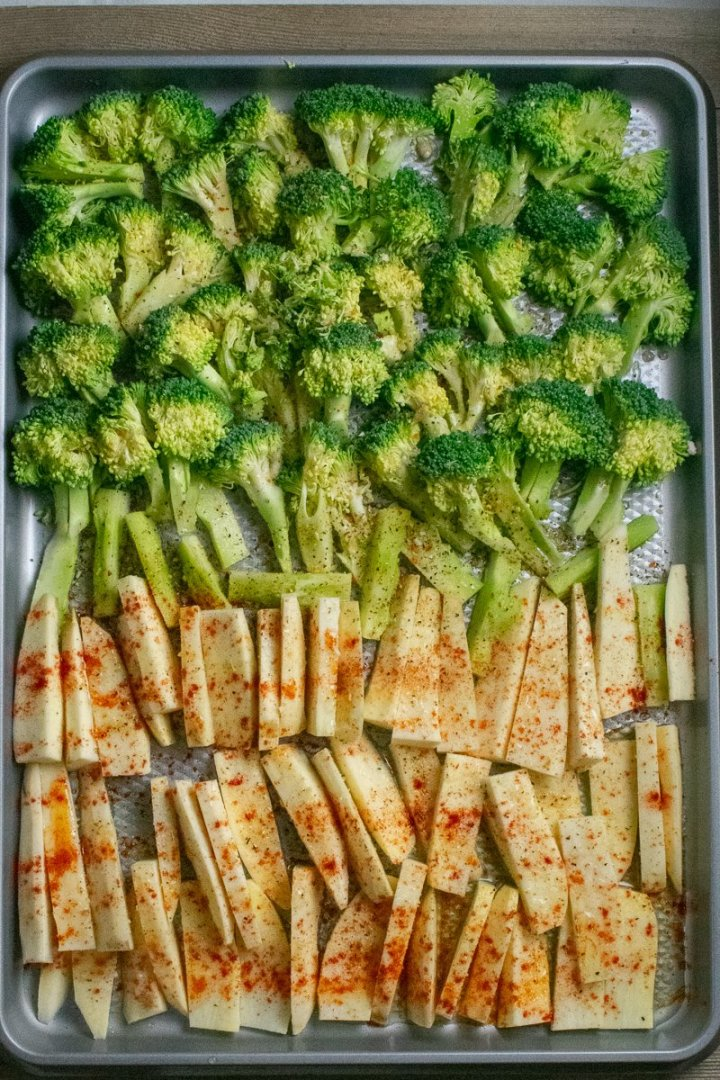 Roasted Broccoli and White Sweet Potatoes raw on baking sheet