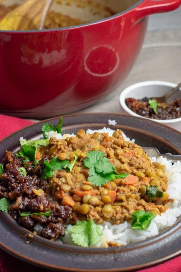 Spiced Lentils with Beef and chutney in brown bowl from side