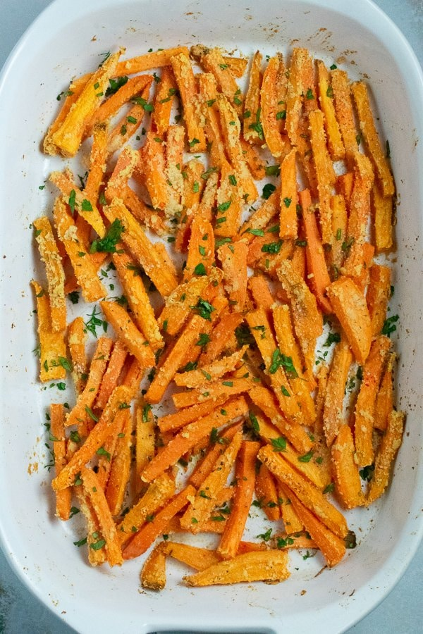 roasted sweet potato fries in white baking dish
