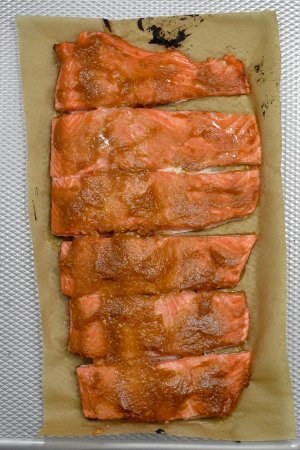 Steelhead fillets spread with miso marinade on baking pan