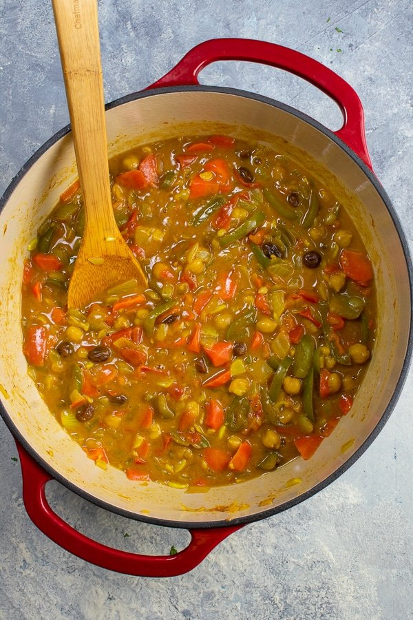 Moroccan stew 2 ways in red handled Dutch oven