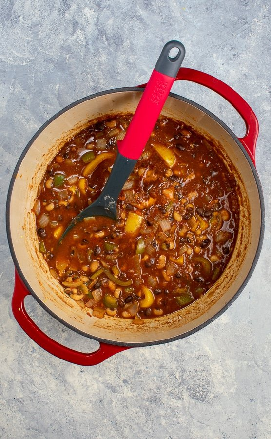 two bean chili 2 ways in cast iron Dutch oven with spoon