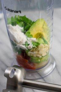 ingredients for creamy avocado lime guac dressing in blender jar