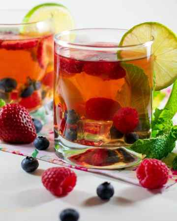 easy fruit infused herbal tea in clear glasses with lime slices