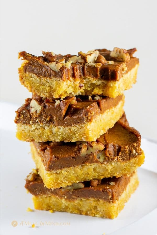 pumpkin pie spice bars gluten free and vegan in stack with pecans