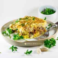 savory gluten-free spaghetti squash Greek pastitsio on white plate