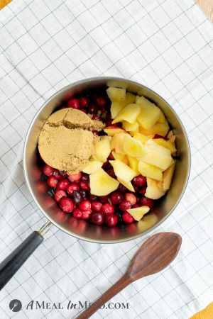 easy cranberry sauce with apples ingredients in saucepan