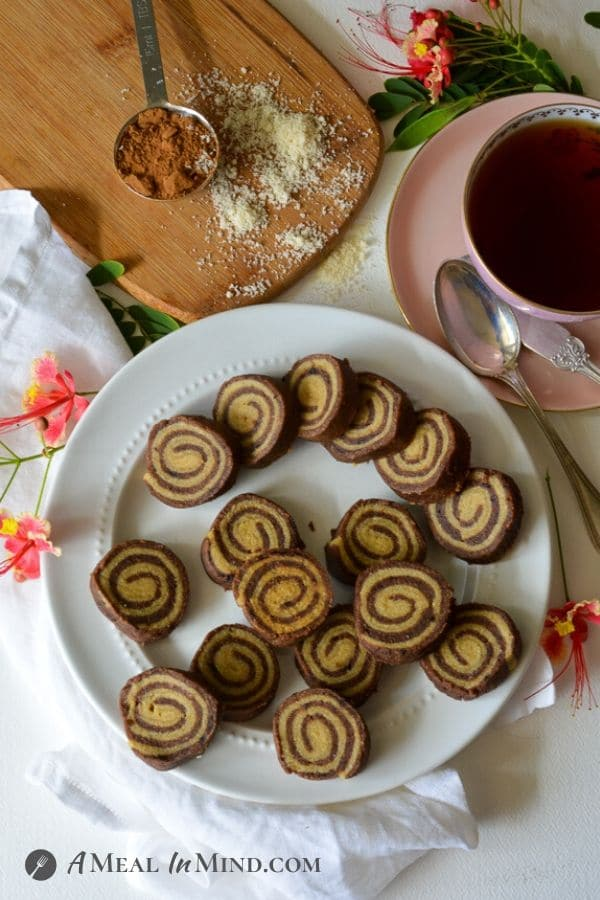 Almond Flour Carob Pinwheel Cookies from overhead with a cup of tea