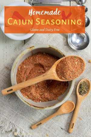 Homemade cajun seasoning in small bowl with spoons