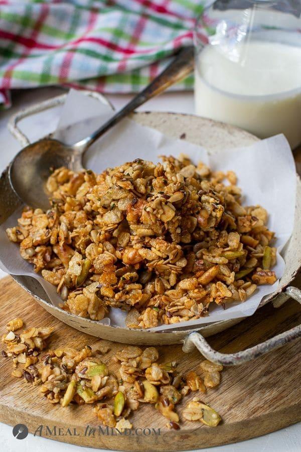 flax hemp granola with rice crisps in shallow bowl with kefir