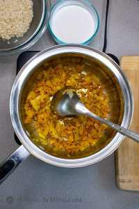 Coconut Turmeric Rice stirring turmeric into onions