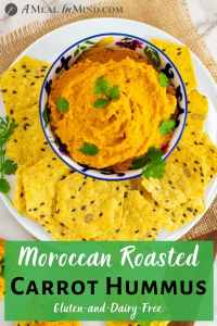Moroccan Roasted-Carrot Hummus in patterned bowl overhead view pinterest image
