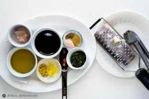 Ingredients for Herbed Balsamic-Honey Vinaigrette on plates