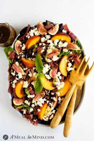 Fig-Peach Pecan Salad with Feta and Balsamic Vinaigrette on large platter
