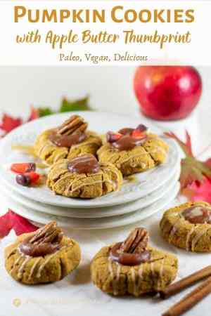 pumpkin cookies with apple butter thumbprint on white plates