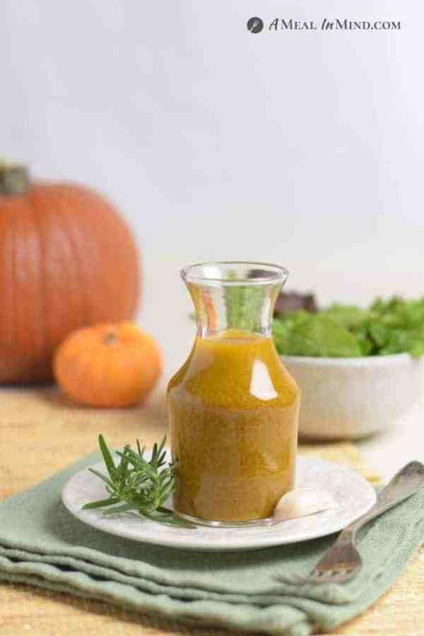 chipotle pumpkin vinaigrette in glass serving carafe