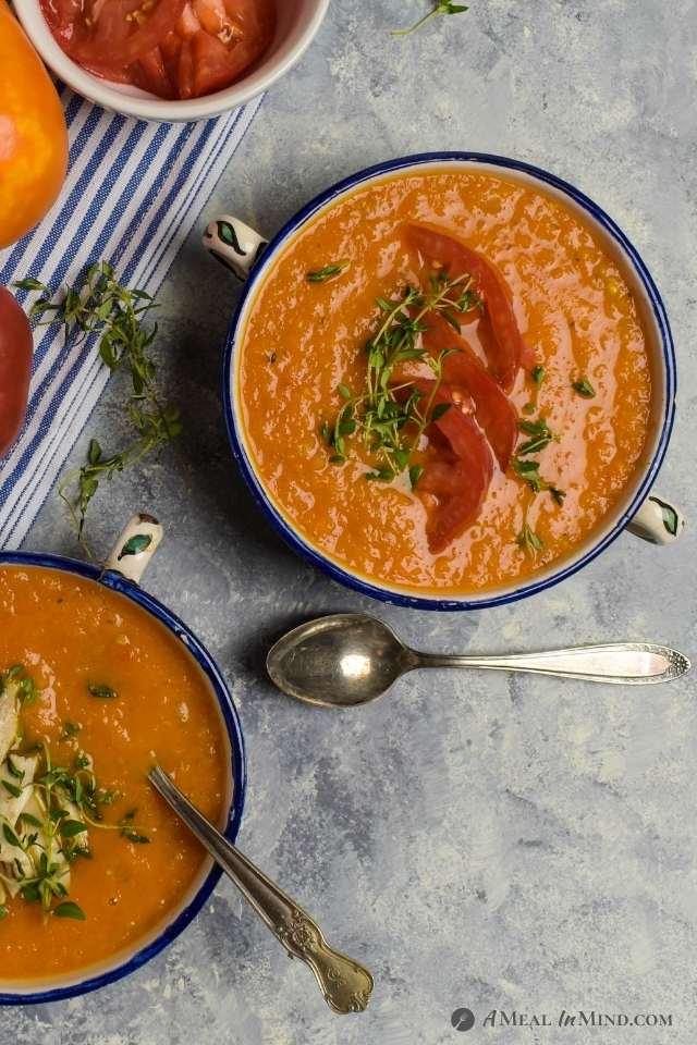 roasted butternut squash tomato soup vegan bowl with tomato garnish