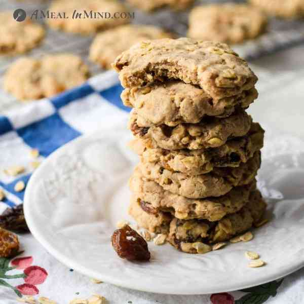 stack of raisin oatmeal cookies on white plate