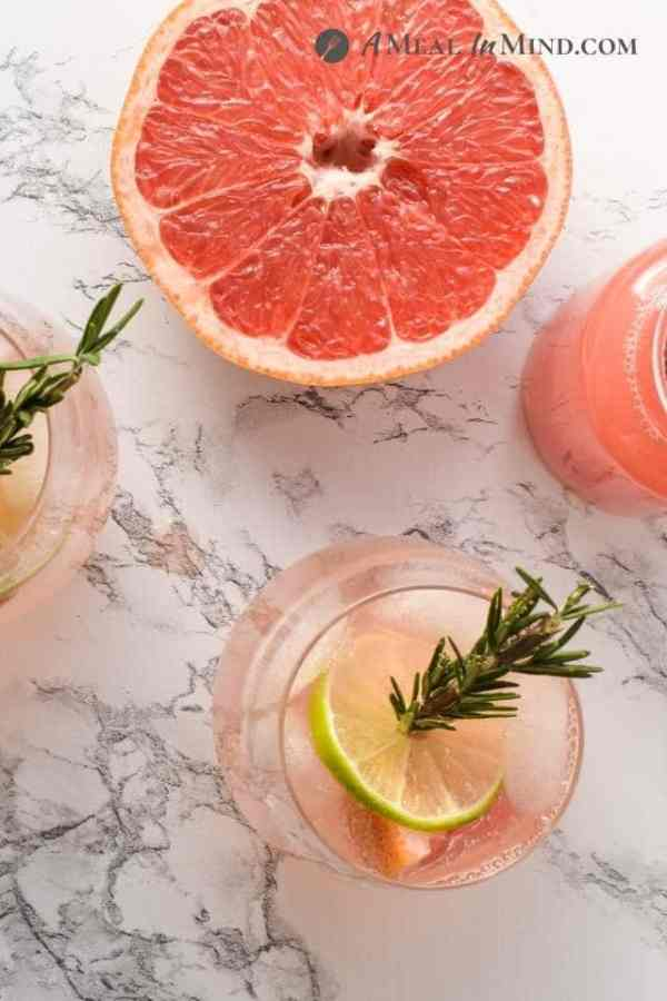 overhead view of paloma mocktails and cut grapefruit