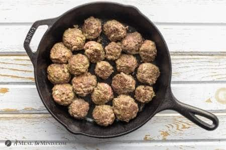 Paleo Pesto Meatballs after searing in iron skillet