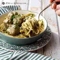 Paleo Pesto Meatballs and Alfredo Sauce on gf pasta in bowl