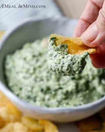 spinach artichoke dip closeup of potato chip