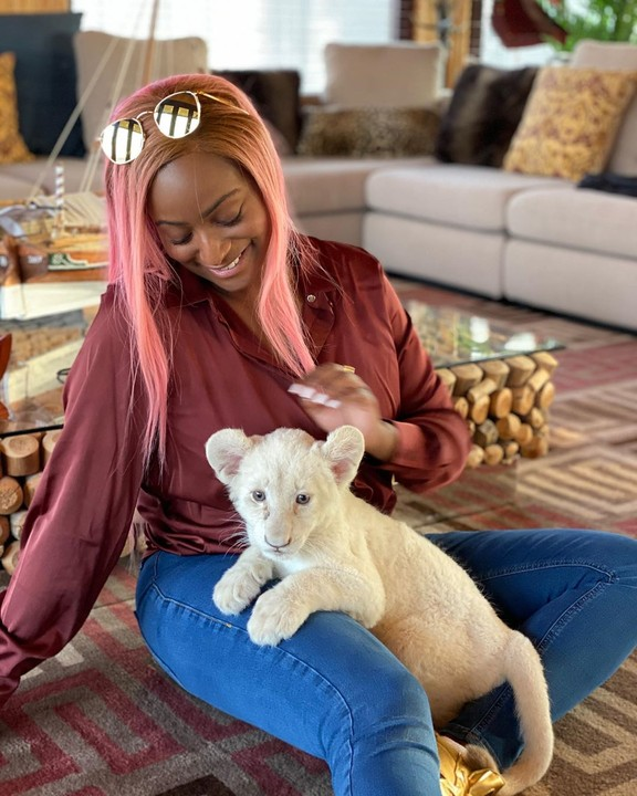 DJ Cuppy Feeds A Baby Lion Named After Her