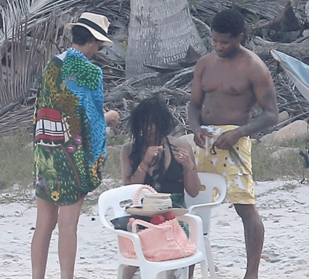 Usher Photo'd Helping His Wife Take Out Her Weave On At The Beach