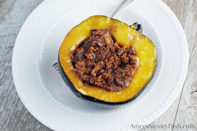 This slow cooker stuffed acorn squash is a sweet/savory side dish that would be perfect for your holiday spread.  It's super easy to throw together and made with whole food ingredients.