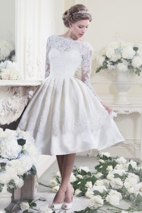 11317 - 50's style T-Length dress with long lace sleeves and keyhole back. A stylish choice for the modern bride.