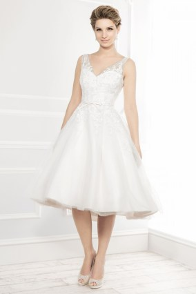 11404 - 50's style T-length tulle dress embellished with lace and finished off with a slim satin bow belt.